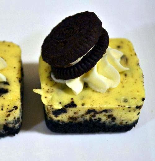 Oreo Cheesecake Squares Topped with Cream and Mini-Oreo Cookie