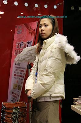 Sales girl with angel wings, Shilin Night Market, Taipei, Taiwan