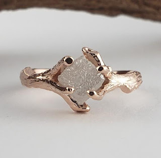 Hand Sculpted Unique One-of-a-kind Engagement Rings with Twigs to hold each Diamond.