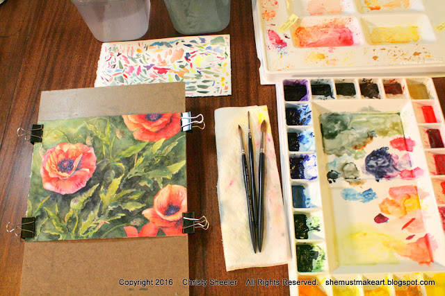 Dancing Poppies watercolor painting completed viewed on studio table.