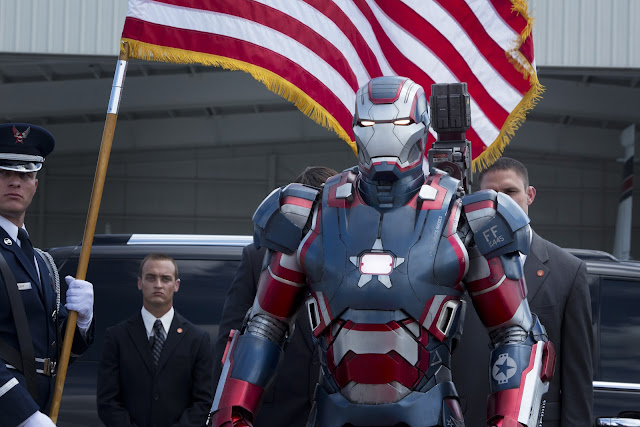 War Machine, his armor now painted in an American flag motif, similar to Captain America's uniform.