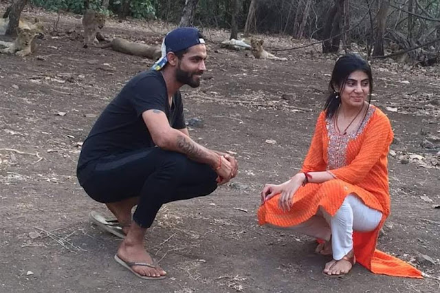 Cricketer Ravindra Jadeja and his wife, Riva Solanki, got into trouble after taking a sefie before a pride of lions at Gir Forest in Sasan on Wednesday.  The cricketer, who was rested from the Zimbabwe series, was visiting Gir National Park and Sanctuary along with his wife. They reportedly got down from a safari jeep and took a series of selfies before a pride of lions.