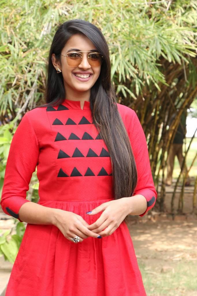 Niharika In Red Dress At Oru Nalla Naal Paathu Solren Press Meet