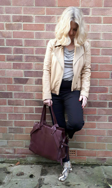 image showing Marks and spencer bag and finery elmworth boots against a background of brick wall