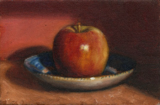 Oil painting of a red apple on a blue and white porcelain saucer.