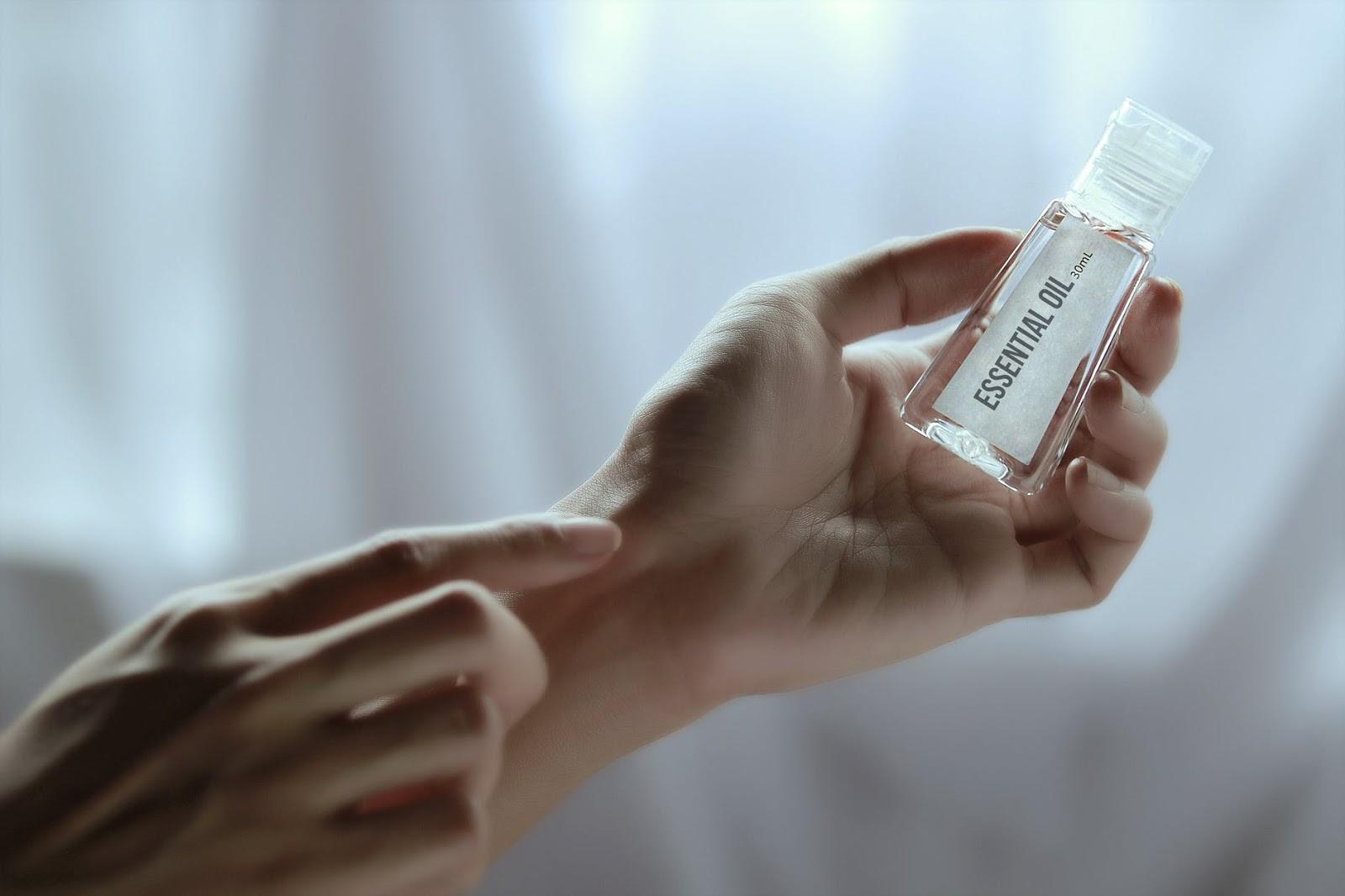 pregnant woman applying essential oil
