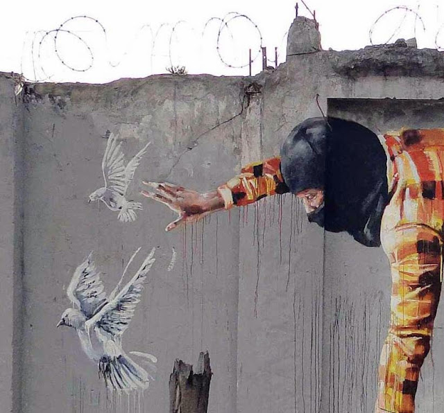 """Australian Street Artist Fintan Magee paints a new mural entitled """"Bad Hunter"""" on the streets of Bogota in Colombia. 2"""