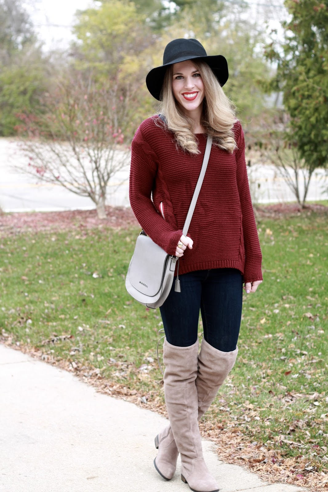 burgundy side zip sweater, Express skinny jeans, OTK taupe boots, black fedora, Michael Kors grey saddlebag