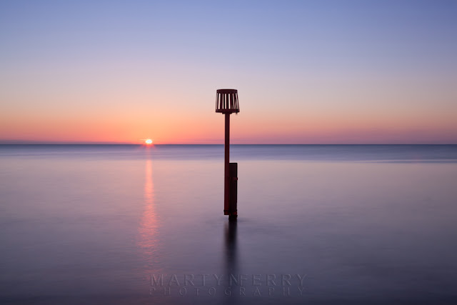 Image of the ocean at Swanage in Dorset at sunrise