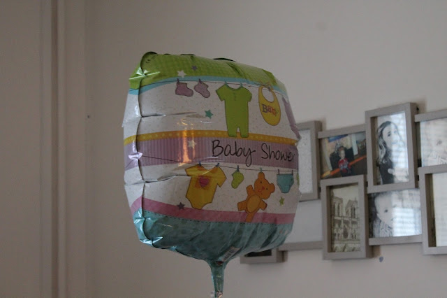 baby shower blog post including game ideas present ideas and decor ideas - baby shower helium ballon