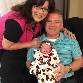 Gil and Kelly Bates with newborn Lexi Webster