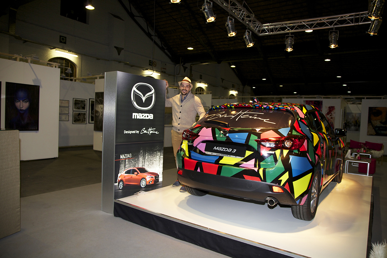 Ben Heine Design on Mazda 3 Car at Brussels Affordable Art Fair (lion made of circles and colorful abstract composition) - 2015