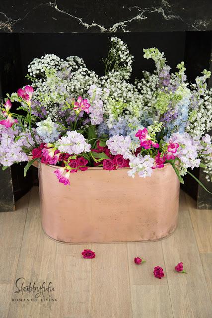 vintage copper bucket flowers