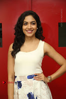 Actress Ritu Varma Stills in White Floral Short Dress at Kesava Movie Success Meet .COM 0013.JPG