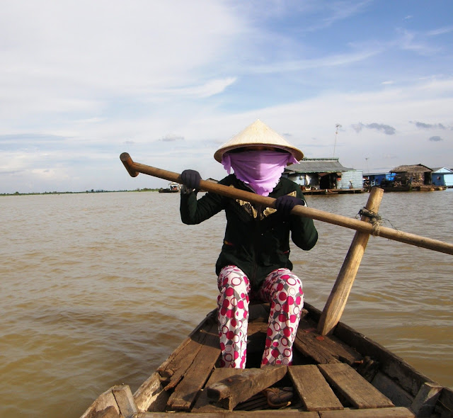 Lady on the Tongle Sap River in Kampong Chhnang, Cambodia