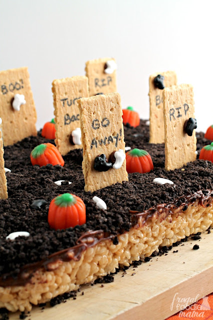"Whip up a 100% edible ""graveyard"" for Halloween this year with these easy to make Haunted Graveyard Rice Krispies Treats."