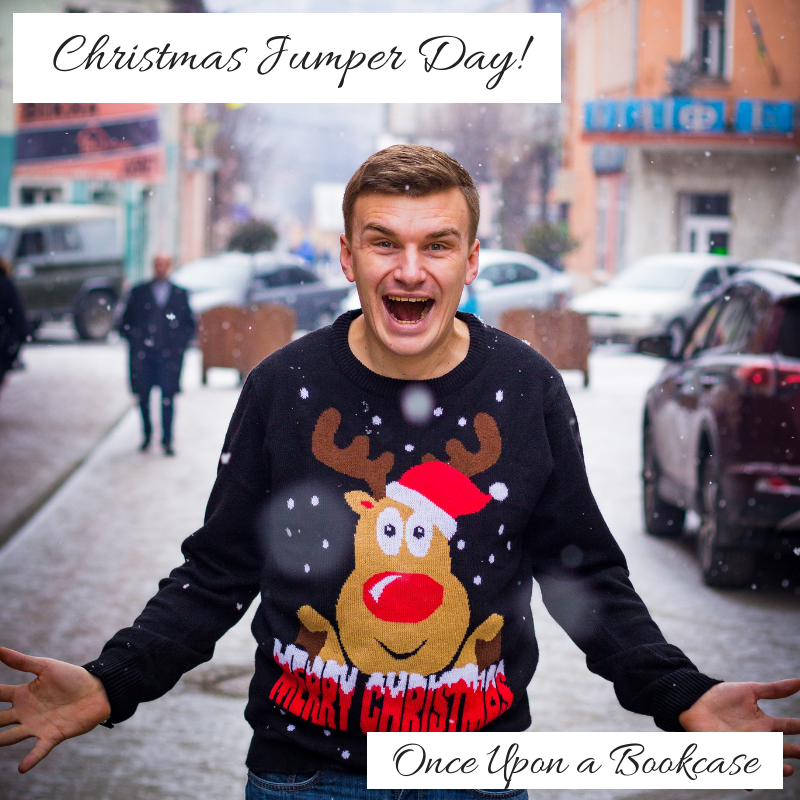 A photo of a man in a navy blue jumper featuring an image of Rudolph saying Merry Christmas, holding his hands out to the side. The photo is edited to show the blog post title and blog title.