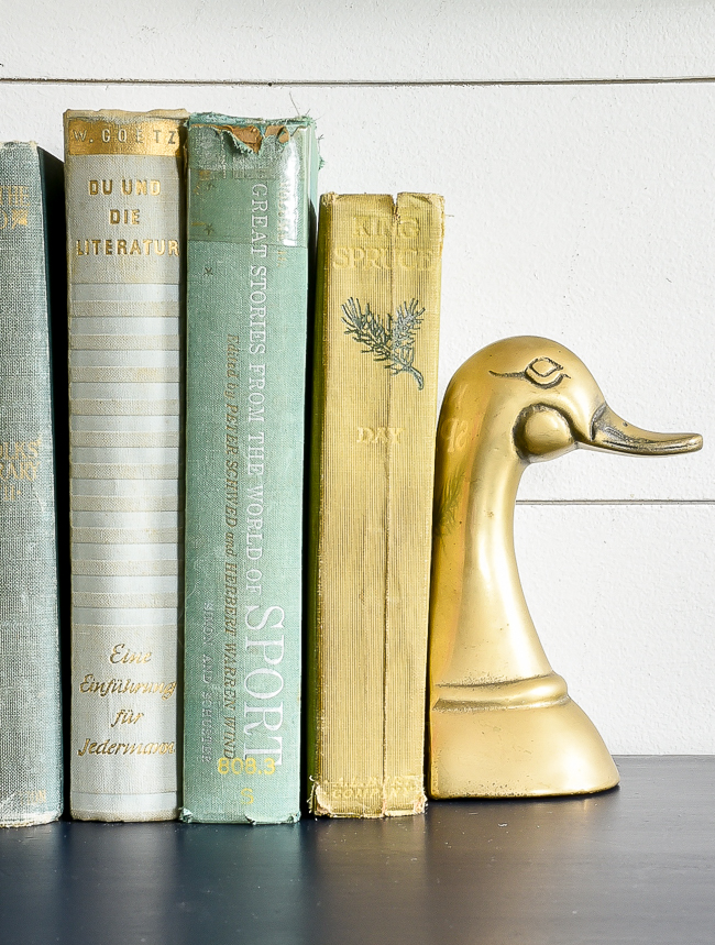 Vintage books and brass duck bookeneds