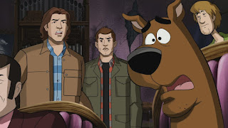 "Jared Padalecki as Sam Winchester, Jensen Ackles as Dean Winchester, Frank Welker as Scooby Doo, and Matthew Lillard as Shaggy in Supernatural 13x16 ""ScoobyNatural"""