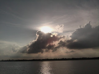 Sun coming out of clouds picture