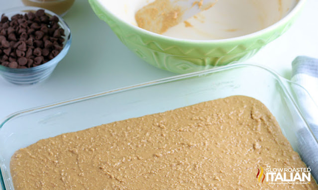 graham cracker crumbs pressed into a glass baking pan