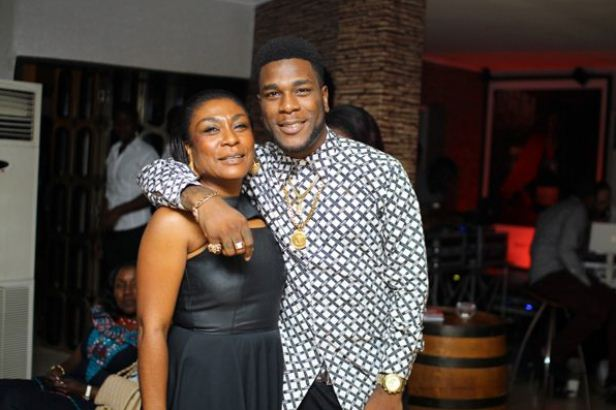 Burna boy hugs mum