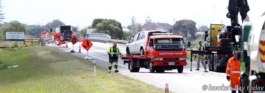 Serious Crash Unit investigation and clean-up after a fatal accident n which a seven year-old boy died, on the Hawke's Bay Expressway (SH2B) in Napier. He was in a car that hit another vehicle that had stopped in a line of traffic at a roadworks site on the bridge between the Prebensen Rd roundabout and Meeanee Quay. photograph