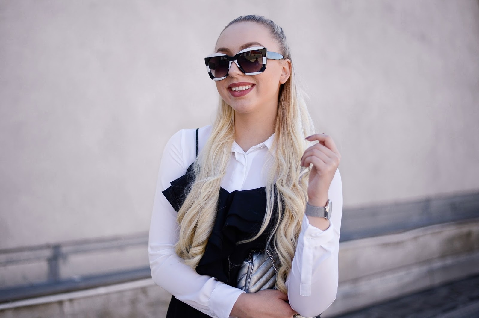 cami over shirt and oversized sunglasses