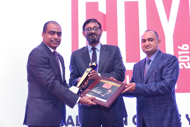 Mr Kiran Koteshwar receiving the AsiaOne Global Asian Award on behalf of...