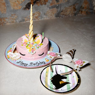 Shay Mitchell unicorn-themed birthday party with cake and  headband
