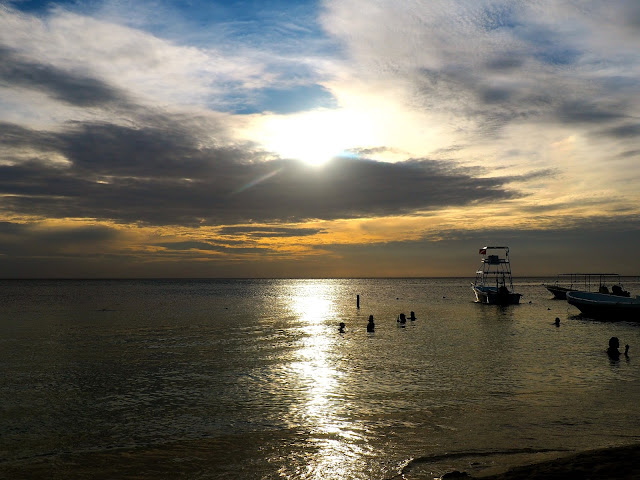 Sunset over the ocean from West Bay Beach, Roatan Island, Honduras