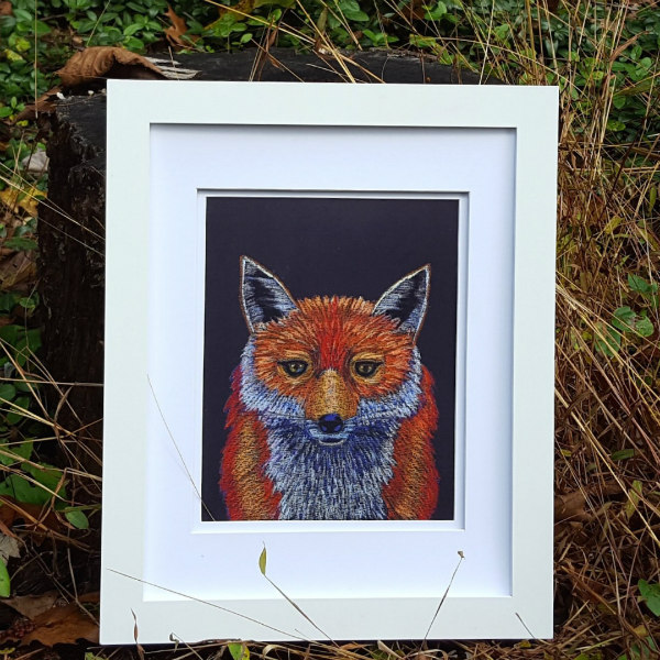 print of an original pastel fox illustration in white frame with woodsy background