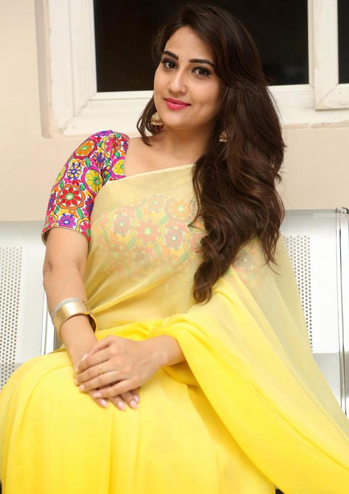 Beautiful Telugu TV Anchor Manjusha Stills In Transparent Yellow Saree