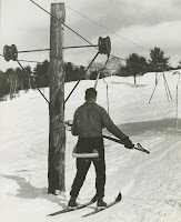 A photograph of a skier from behind.