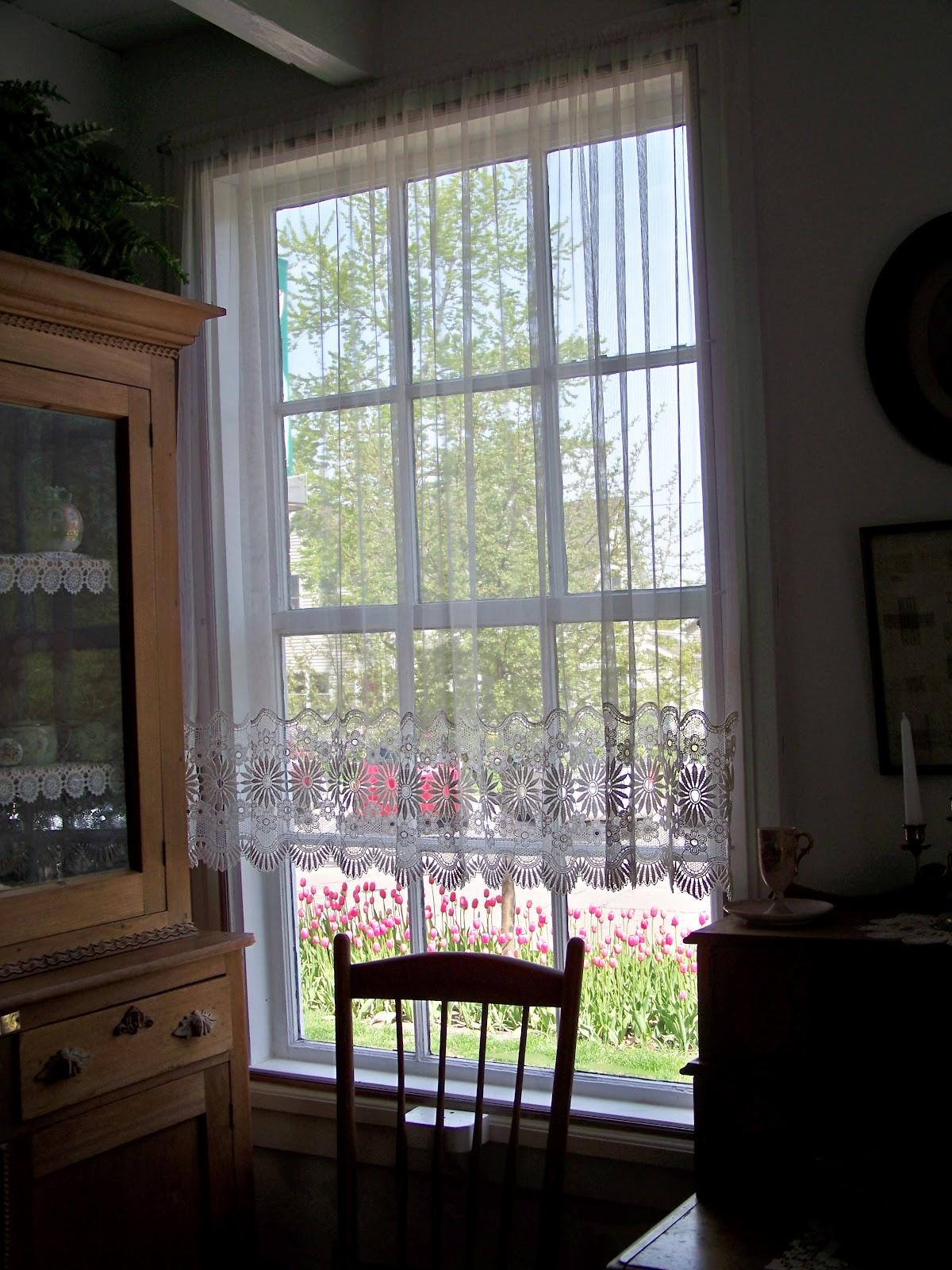 Tell Me A Story Pella Through My Window