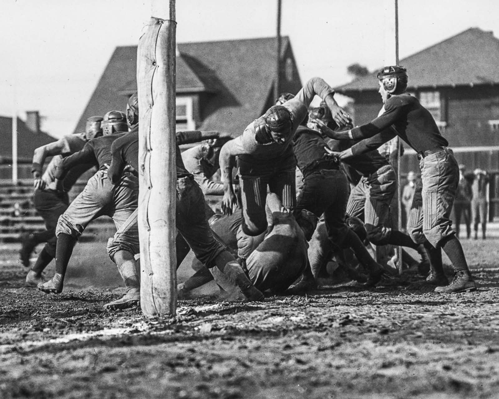 The University of Southern California Trojans football team compete against the Los Angeles High School Romans at the Los Angeles Memorial Coliseum. 1915.