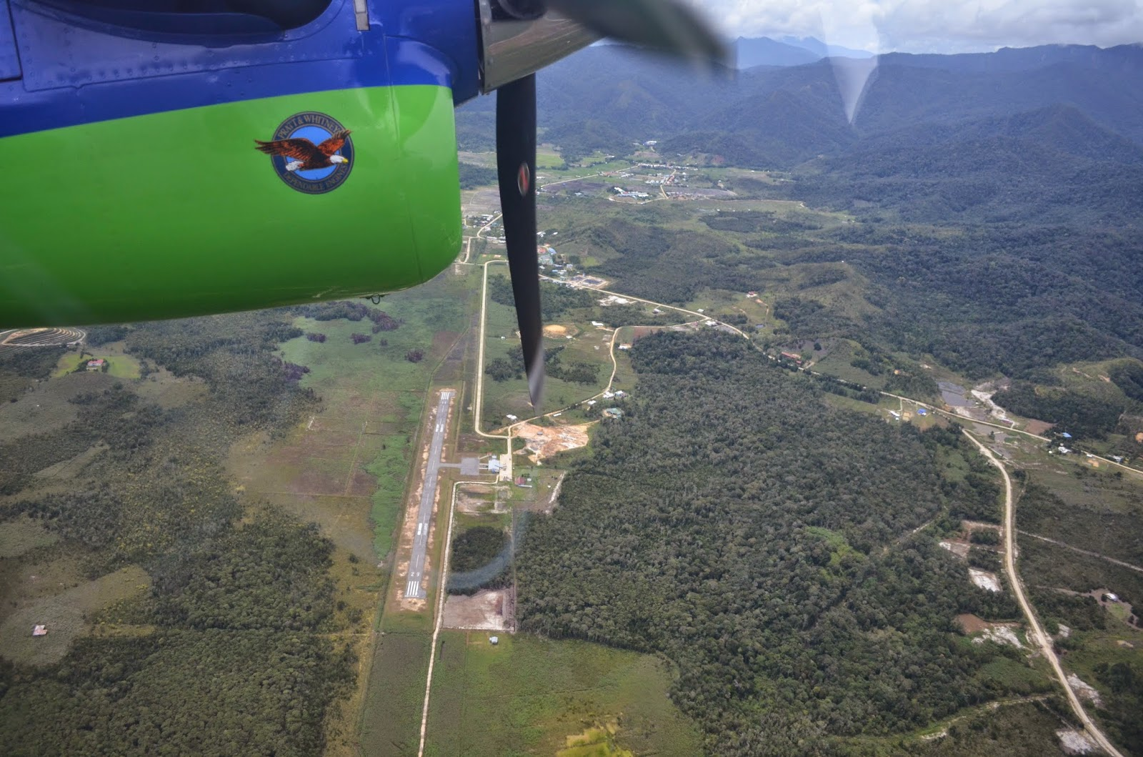 MASwings plane arriving at Bario Highlands