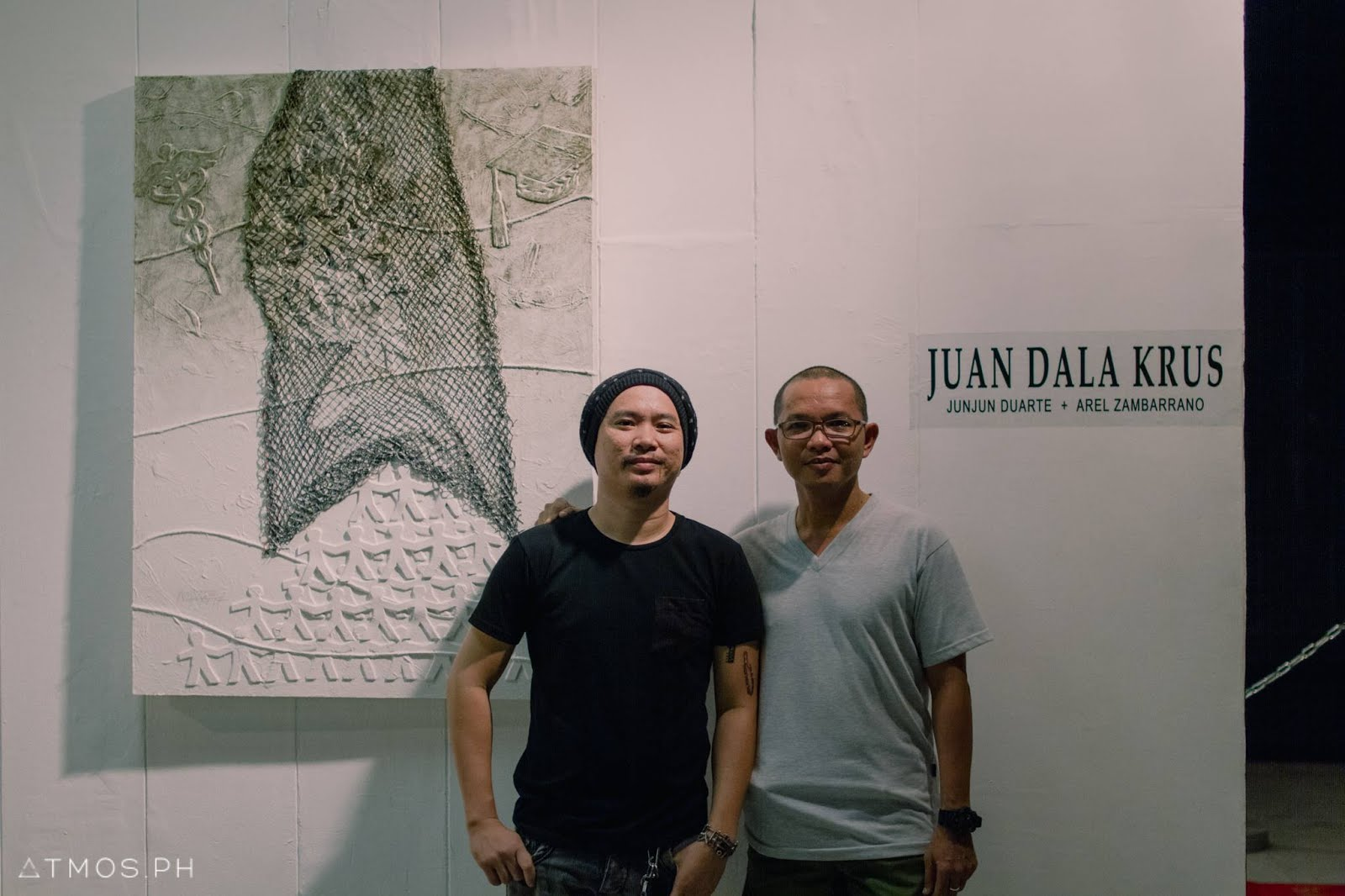 "Arel Zambarrano and his mentor Angelo ""Junjun"" Duarte offer an apt embodiment of this dictum with two-man show ""Juan dala Krus,"" which opened at Museo Iloilo on Nov. 17, unapologetic in its exploration of the ills of Philippine society and the institutions that have enabled them: Two-faced churches, colonial mentality, and a largely patriarchal culture, among others. Art, Juan dala Krus, Museo de Iloilo, Community, Arel Zambarrano, Angelo ""Junjun"" Duarte, Society, Commentary, Exhibit,"