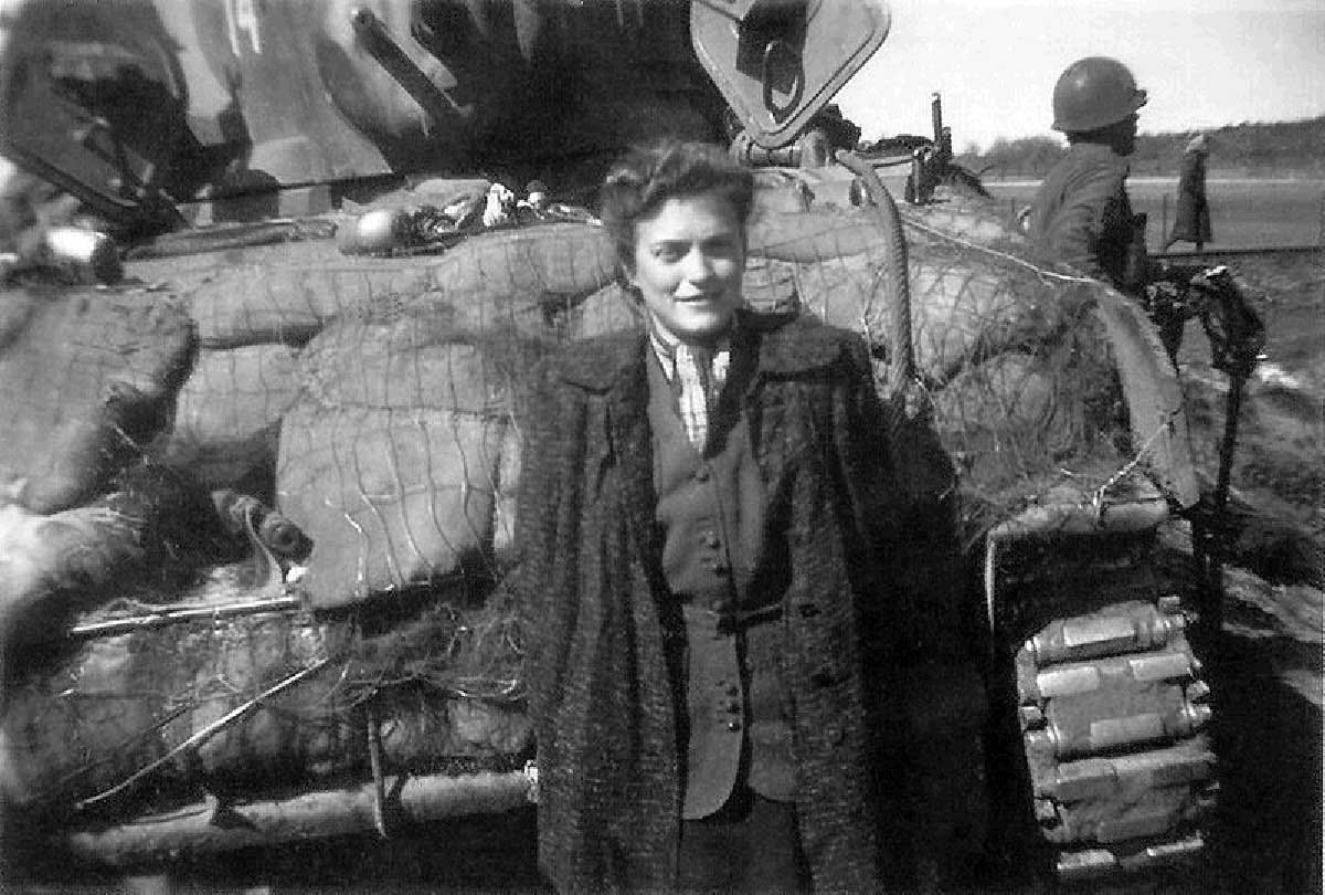 This is Gina Rappaport, who spoke very good English and spent a couple hours telling her story to the American troops. She was in the Warsaw ghetto under terrible conditions, and then was sent to Bergen-Belsen.