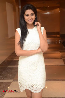 Model Shamili Pictures in White Short Dress at 101 Trends Exhibition Press Meet  0005.jpg