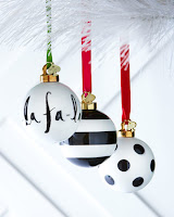 Black and white Christmas ornaments on green and red ribbons