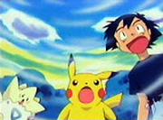 Ash, Pikachu y Togepi sorprendidos
