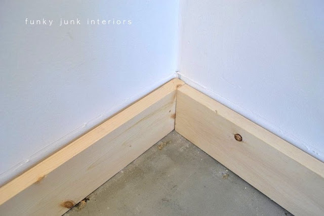 Learn how to build easy baseboards using stock lumber! No fancy miter cuts needed! An easy way to achieve a modern farmhouse look.