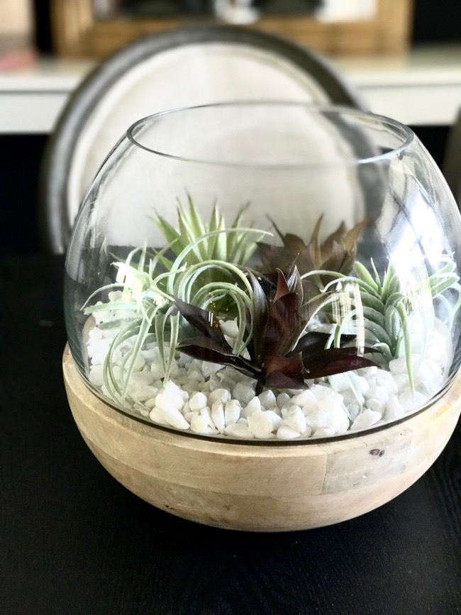 the items used for this are the glass wood vessel faux succulents and white rocks that s it super simple