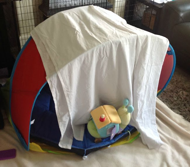 play tent covered with white sheet to make a den