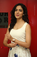Actress Ritu Varma Stills in White Floral Short Dress at Kesava Movie Success Meet .COM 0056.JPG
