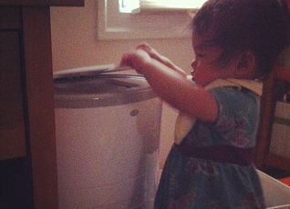 Image: She's discovered her diaper pail!