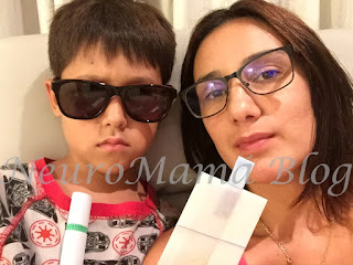 NeuroMamá Blog and son wearing glasses sporting a badass attitude