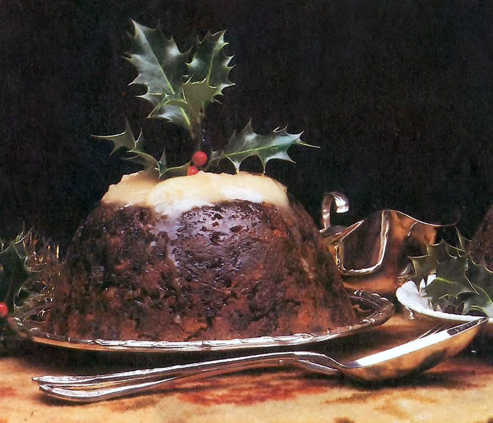 6d09b6ac26b90 Traditional steamed rich christmas pudding topped with white sauce and a  sprig of holly