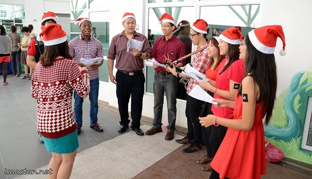 Christmas carolers singing their hearts out